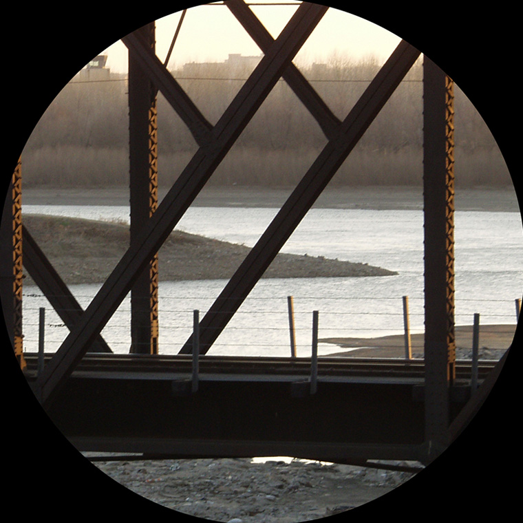 View of Confluence Station, view of the confluence of the Missouri and Kansas Rivers (through a railroad bridge). Photo: Tim Dalton
