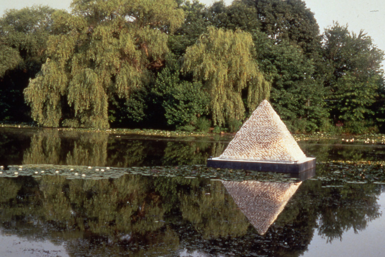 Lake view, Roger Williams Park.  3,000 clamshells, wood, steel pyramid 10 x10 x 8'. Steel float 12 x12 x12'.