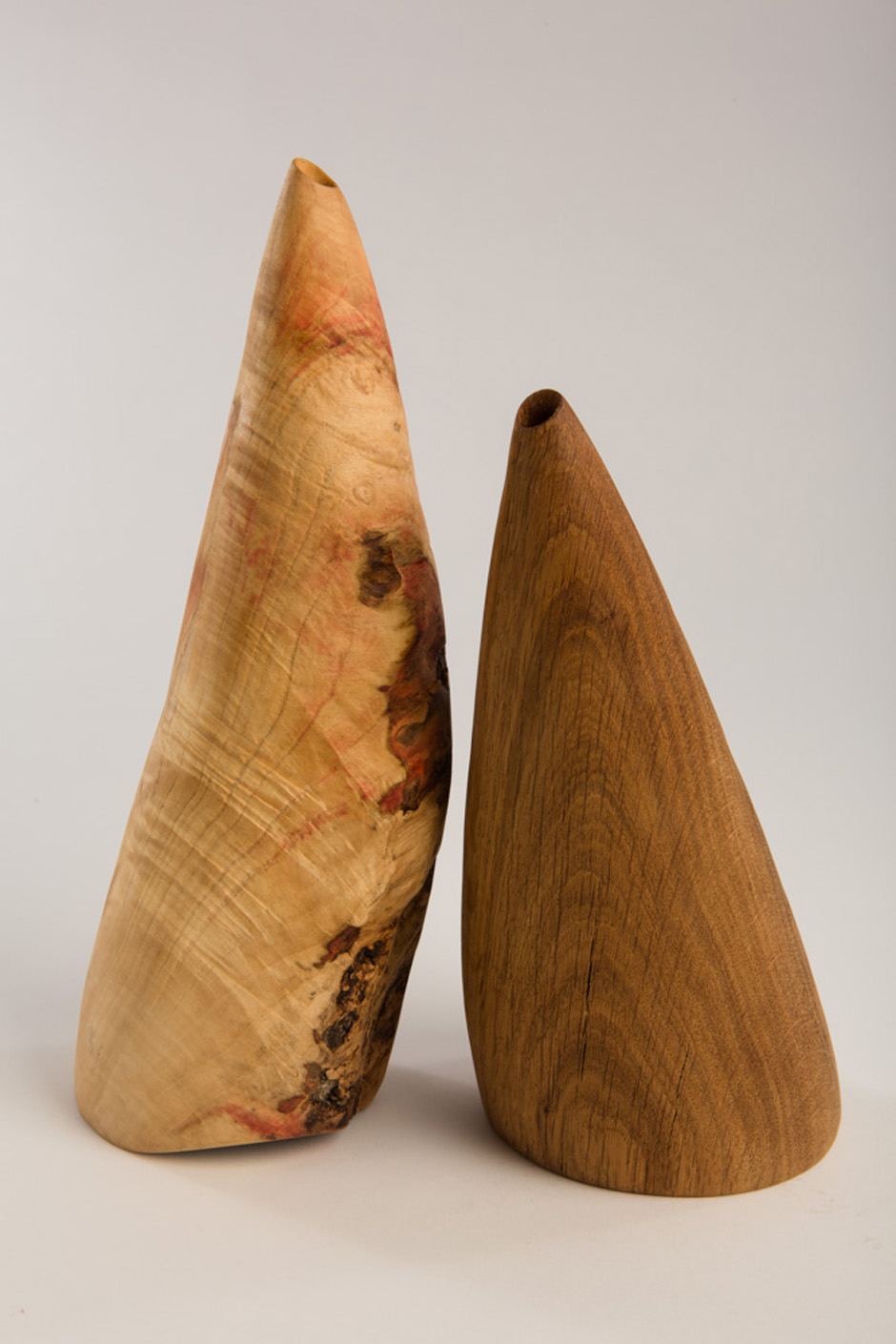 "L-R Belder, Box Elder, beeswax. linseed oil, 4"" diameter x 11"" high and Oak, Oak, beeswax. linseed oil, 4.5"" diameter x 8"" high (with linen sac) Photography: Stacey Evans"