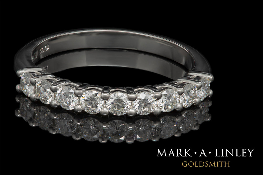 Platinum 9 stone diamond eternity ring