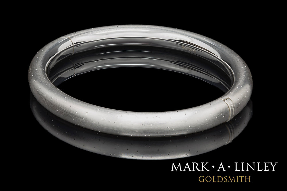 Silver-diamond-cut-bangle.jpg