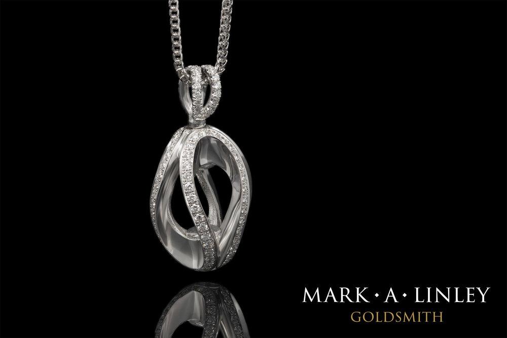 18ct-white-diamond-infinity-catch-pendant.jpg