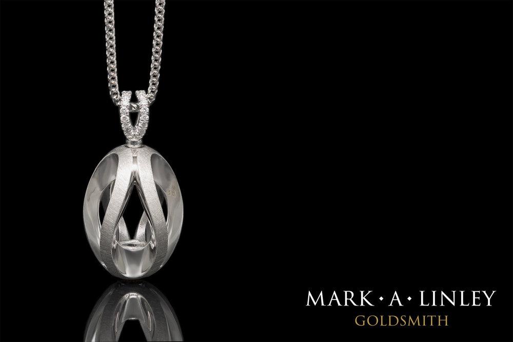 18ct-white-infinity-catch-pendant.jpg