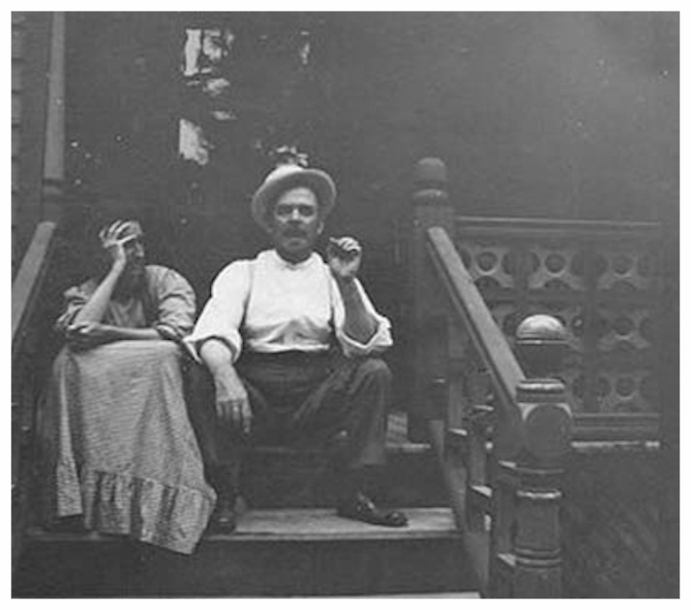 Original Builder Mr. & Mrs. C. W. Fraser on their back porch of their Main Street home