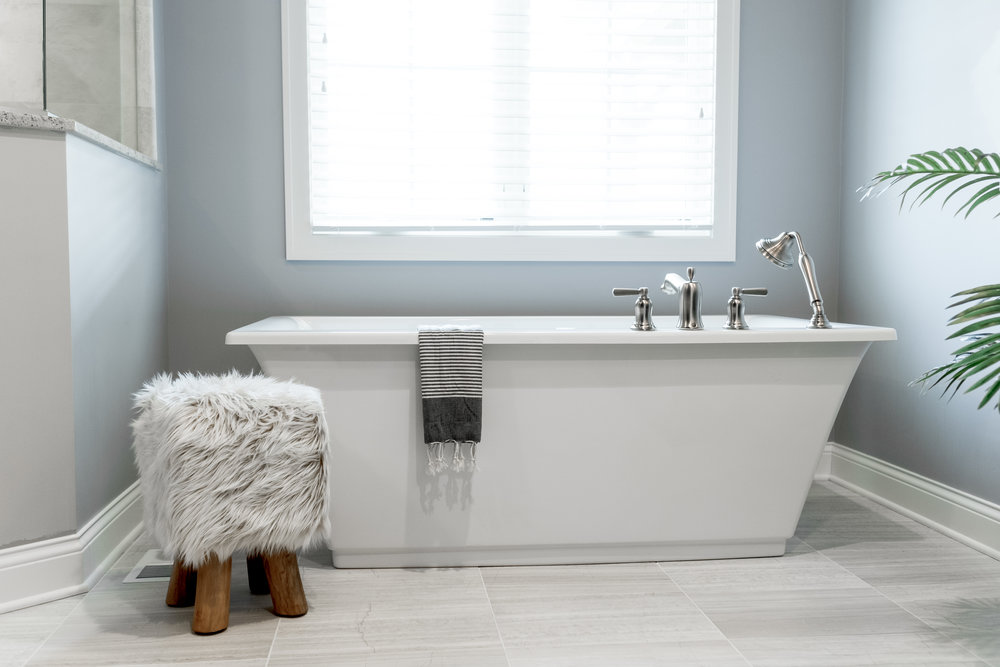 Freestanding tub with chrome accents
