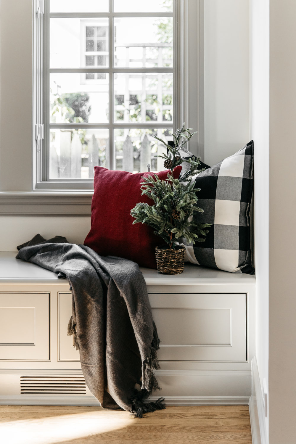 Cozy bench with throw pillows and a blanket