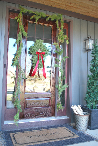 Front porch Christmas decor with garland and wreath