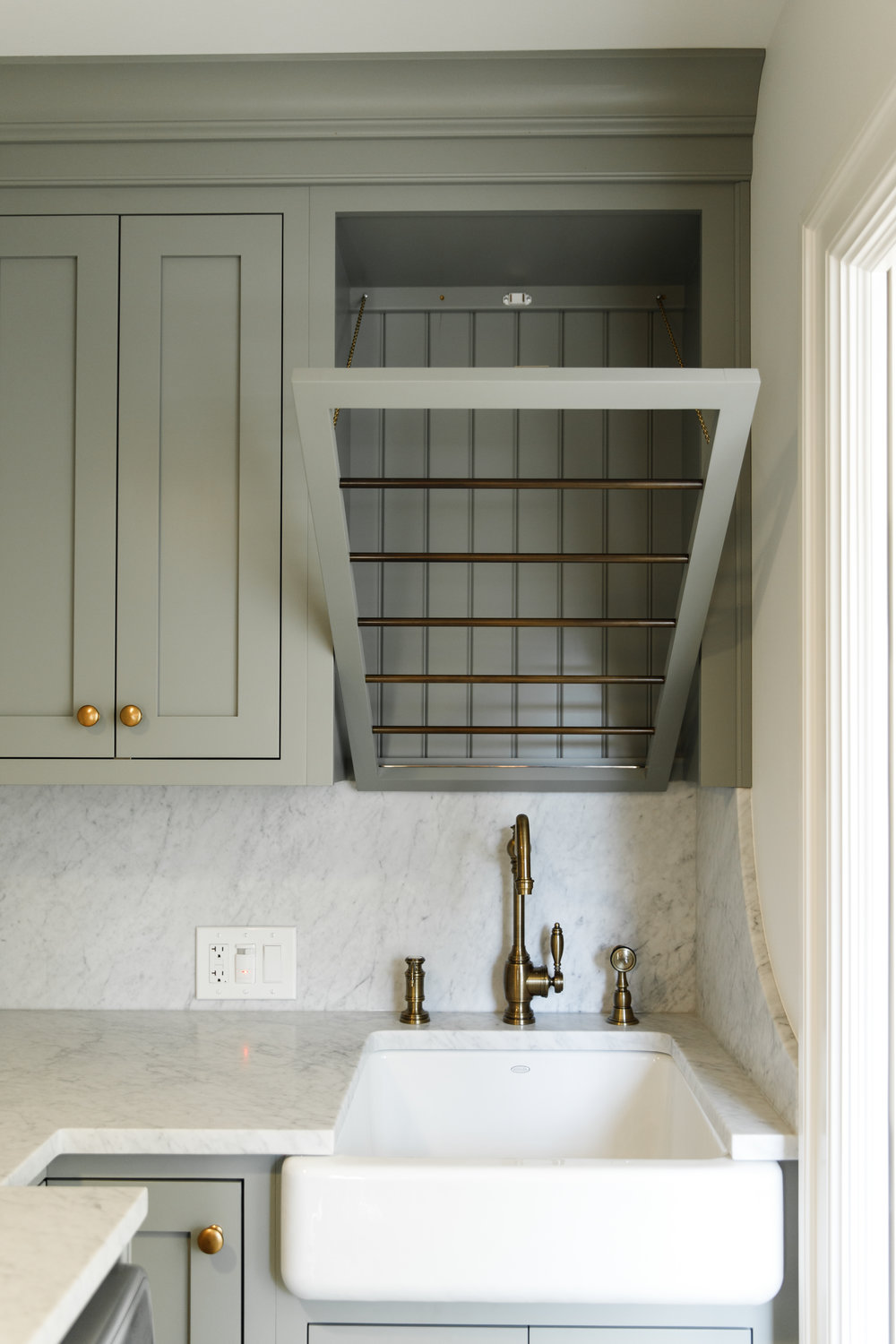 Laundry Room with custom cabinets, gold hardware and farmhouse sink