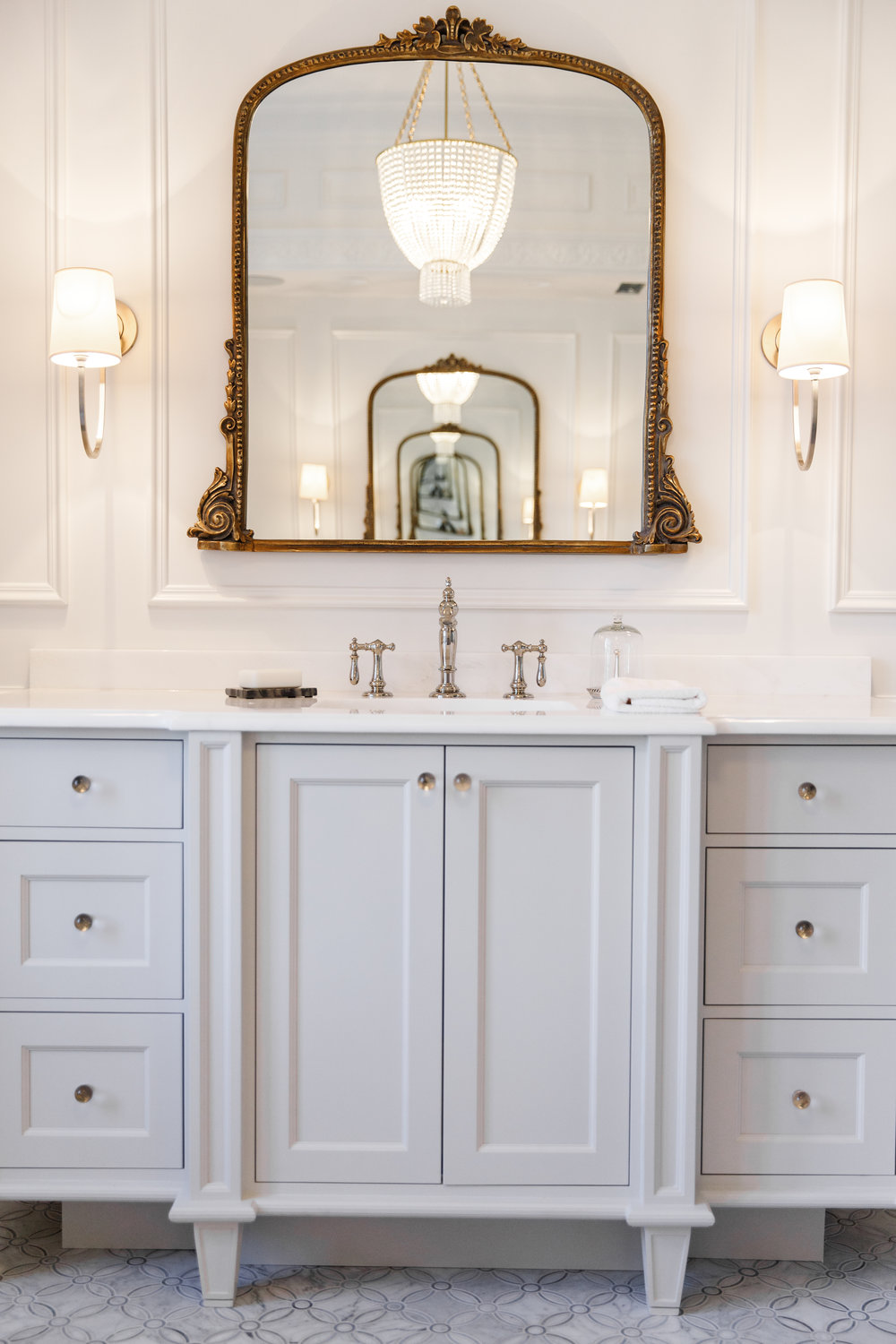 white custom vanity with golf vintage mirror and intricate tile