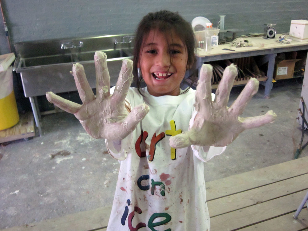 Kid with dirty hands at Camp.jpg