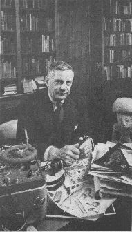 "AUTHOR WASSON sits in New York home with recorder, mushroom pictures and ""mushroom stone."" A onetime newspaperman, he took up banking in 1928."