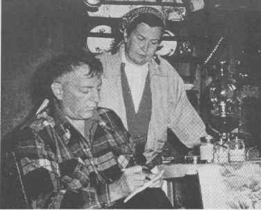 ON MORNING after eating mushrooms, Wasson and his wife review his notes, taken in the dark. Jars contain mushrooms later sent to Heim.
