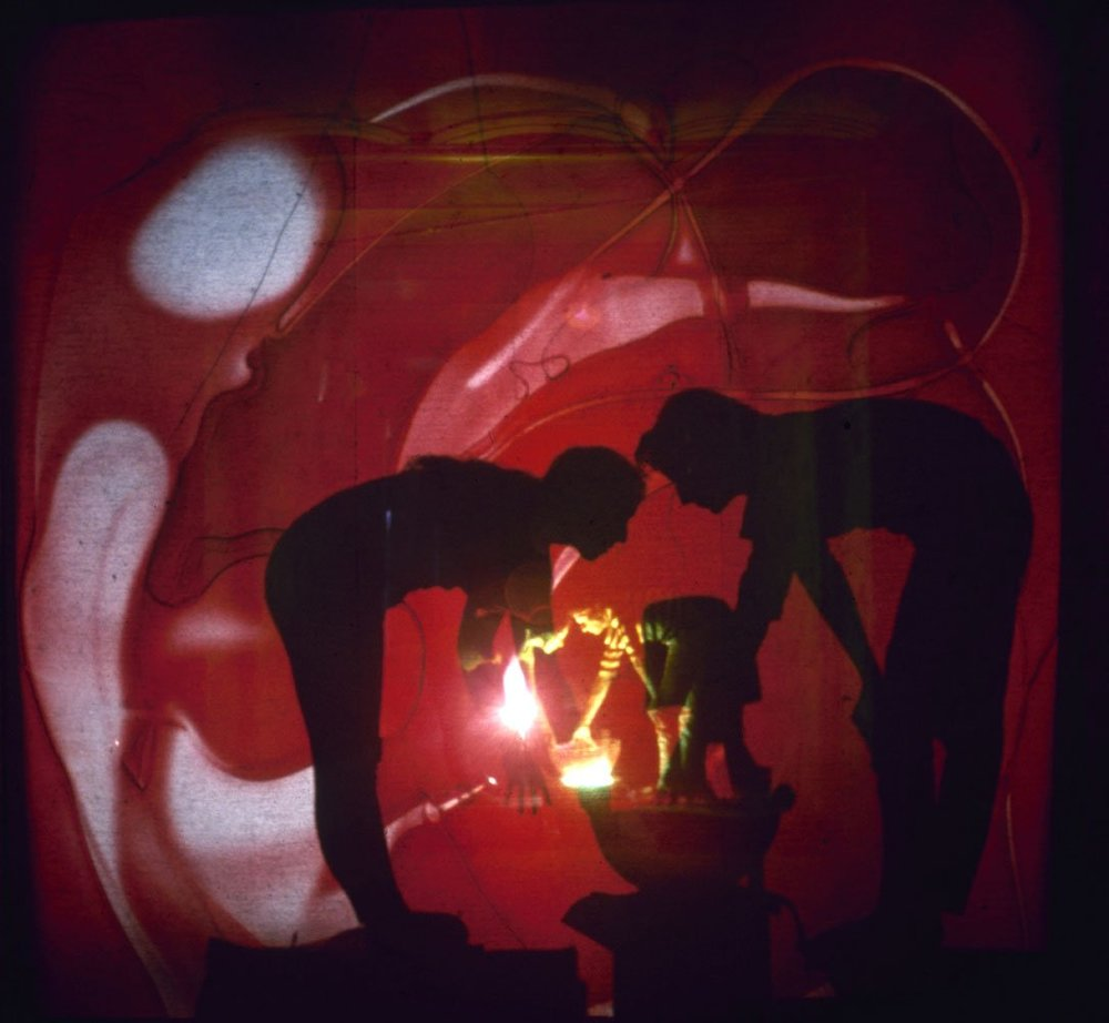 Mind Releaser:    Seen through screen, Cassen and Stern work on psychedelic slide show