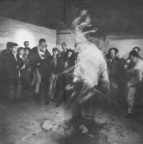 """Los Angeles """"acid heads"""" (LSD users) and spectators watch member of troupe called the Acid Test dance under the influence of the drug, using flashing lights to heighten its effects."""
