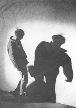 """A user, """"freaking freely"""" at a session of the Acid Test group in Hollywood, gyrates with his own shadow until he collapses."""