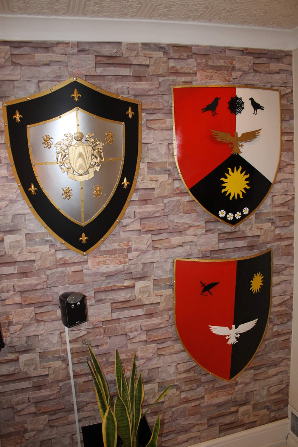 Black/red shields contain specific heraldry for house Orzel members. Black/silver shield = fictitious.