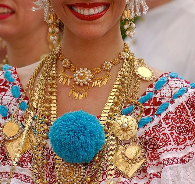 Close up of how the jewelry is worn with the Pollera.