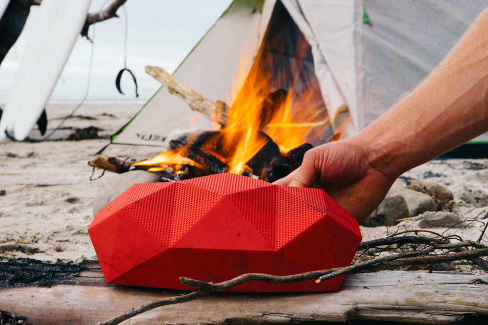 OutdoorTech product photograph while camping next to fire on surf trip - The Beans and Rice Commercial Outdoor Adventure & Lifestyle Content