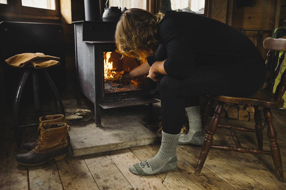 Farm to Feet sock product photography in rustic cabin - Footwear and Sock Photography - The Beans and Rice Commercial Outdoor Adventure & Lifestyle Content