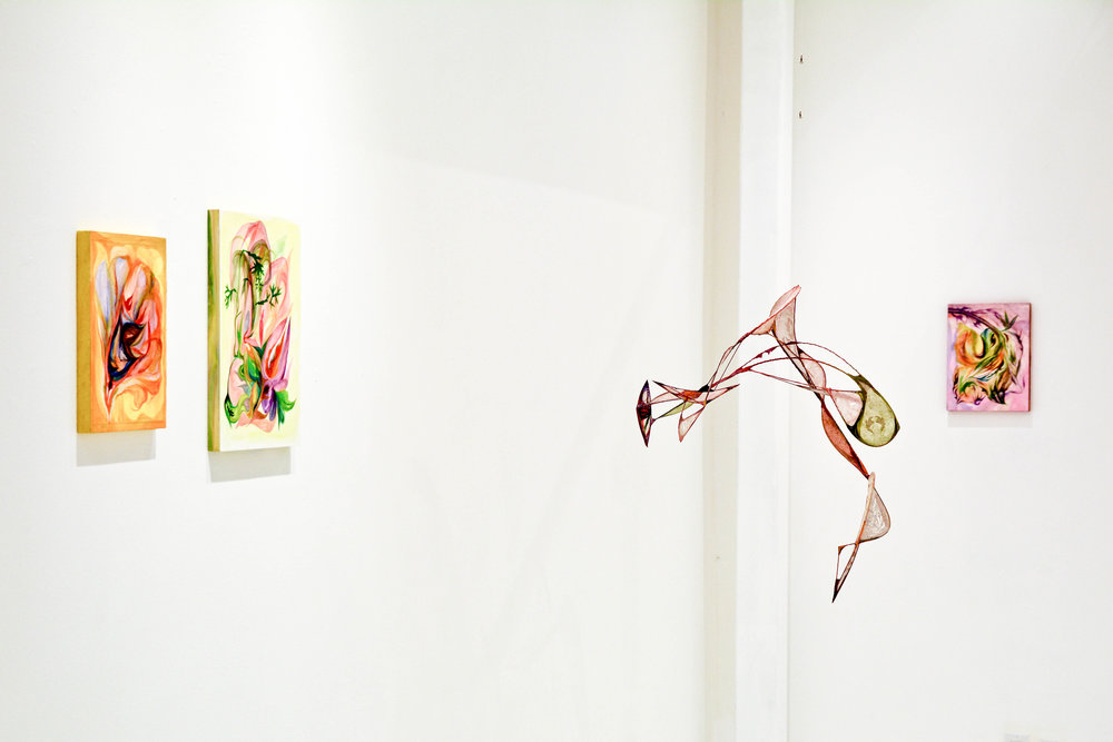 """Glass Face"" with paintings ""Canary Split"", ""Mouse Ears"" and ""Spider Veins"" (left to right)"