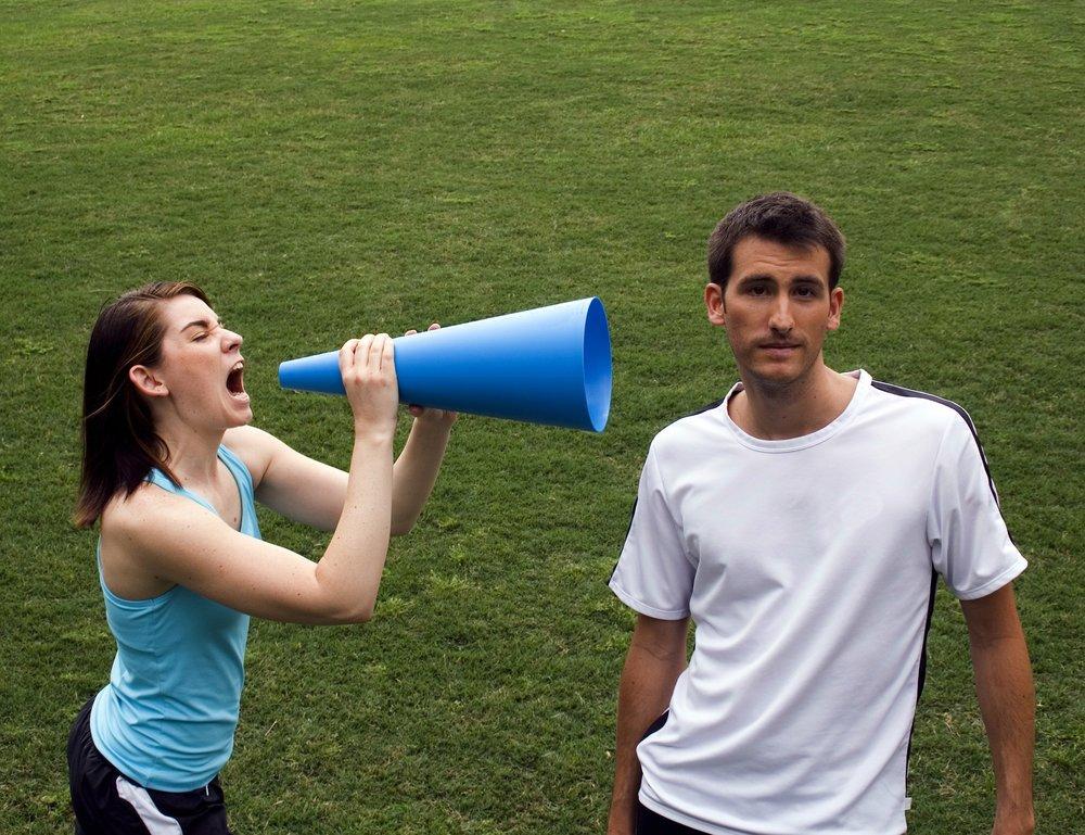 woman w megaphone talking to man.jpg