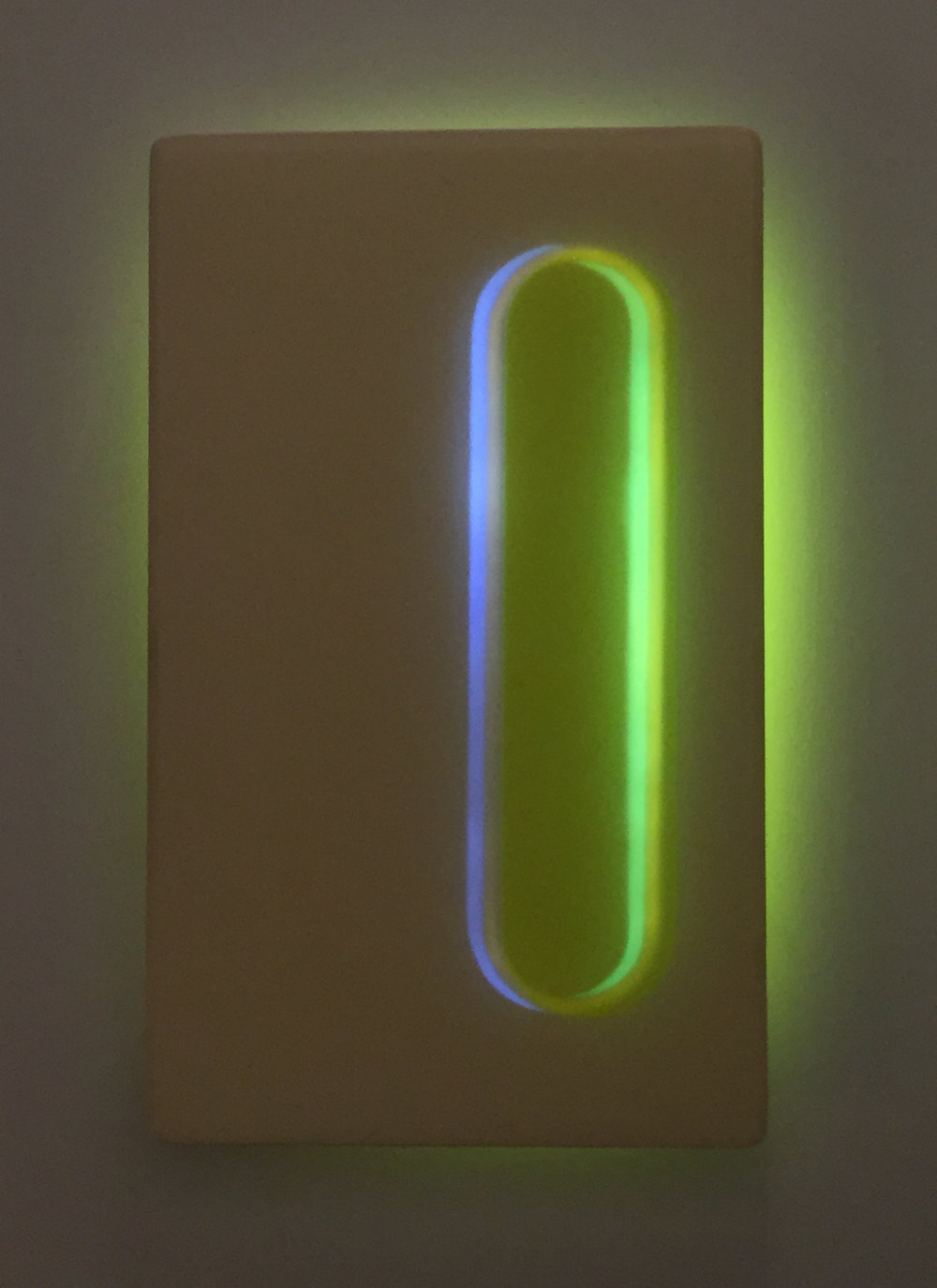 Light sculpture made of resin, acrylic, wood, and LED, with blue and green colors entitled Beacon 2 Night.