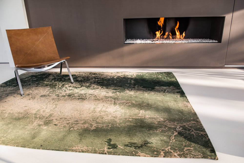 Modern, contemporary home with Louis de Poortere rug entitled Cracks in Dark Pine in black, white and gray colors.