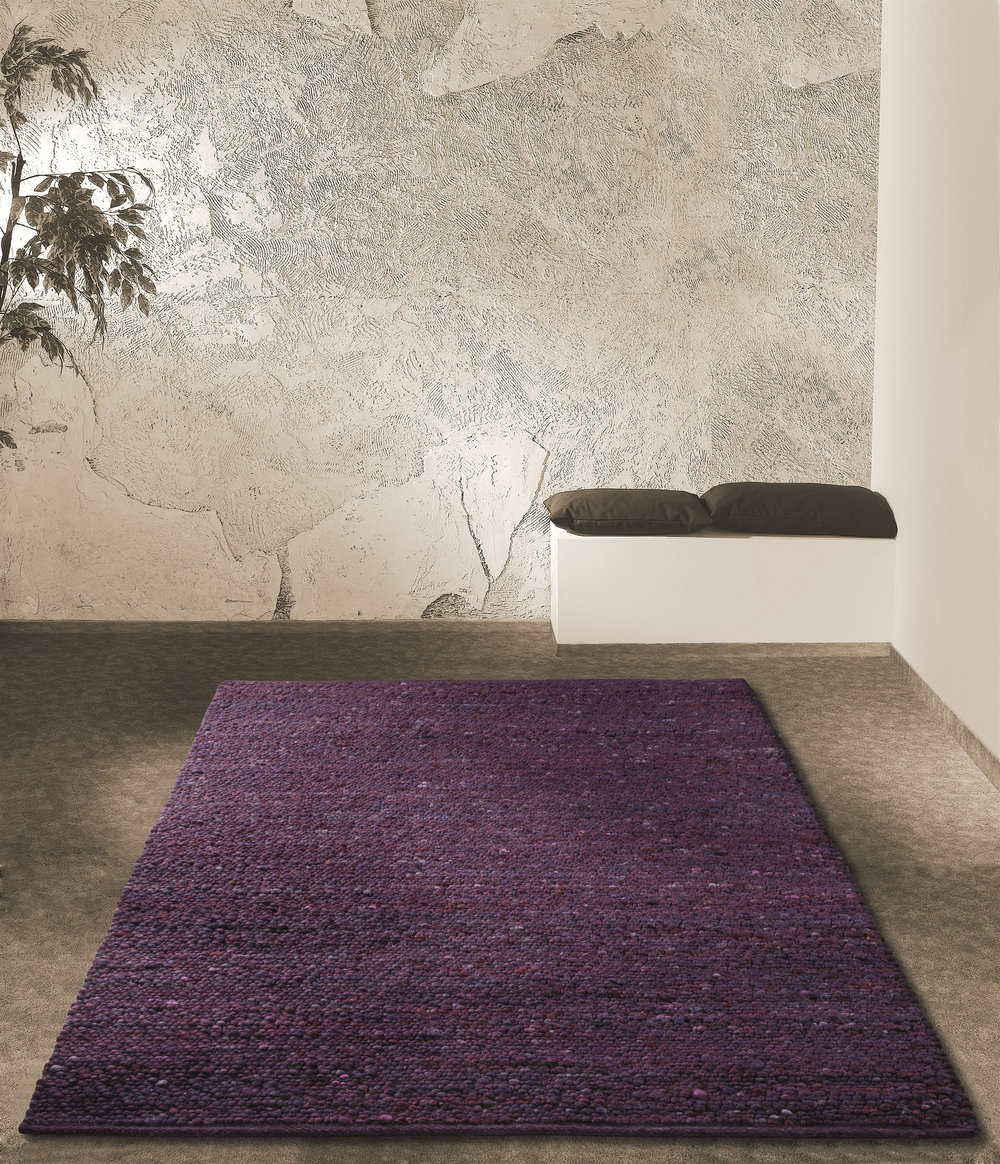 Modern, contemporary home with a purple rug woven with New Zealand Felted Wool.