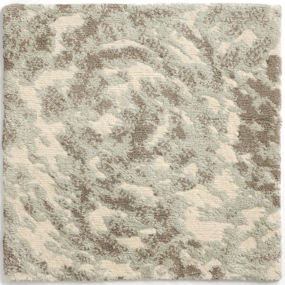 Hand-knotted, wild silk rug with abstract design in gray silver cream.
