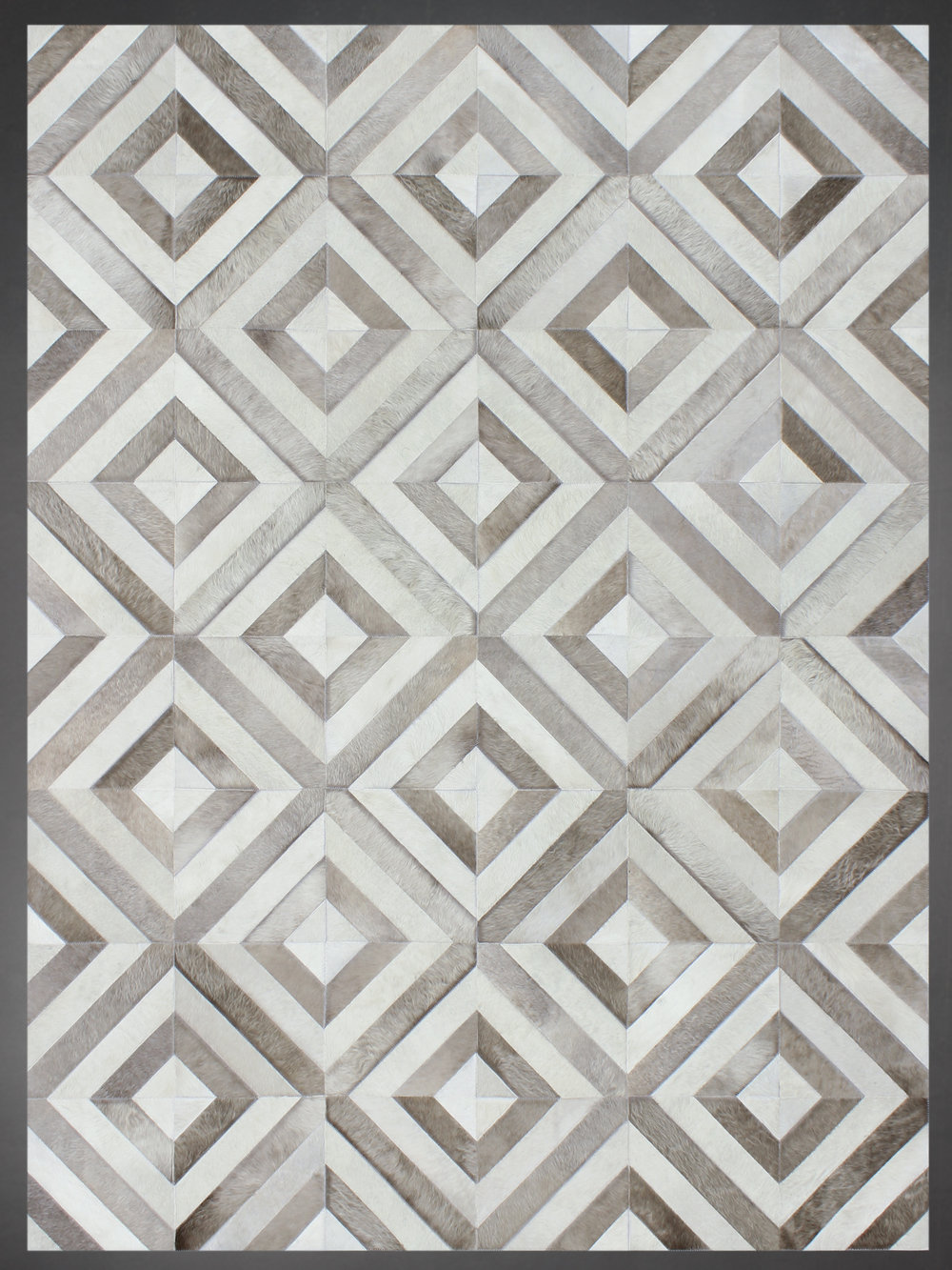 Contemporary designed fur rug in a woven pattern in grays and browns.