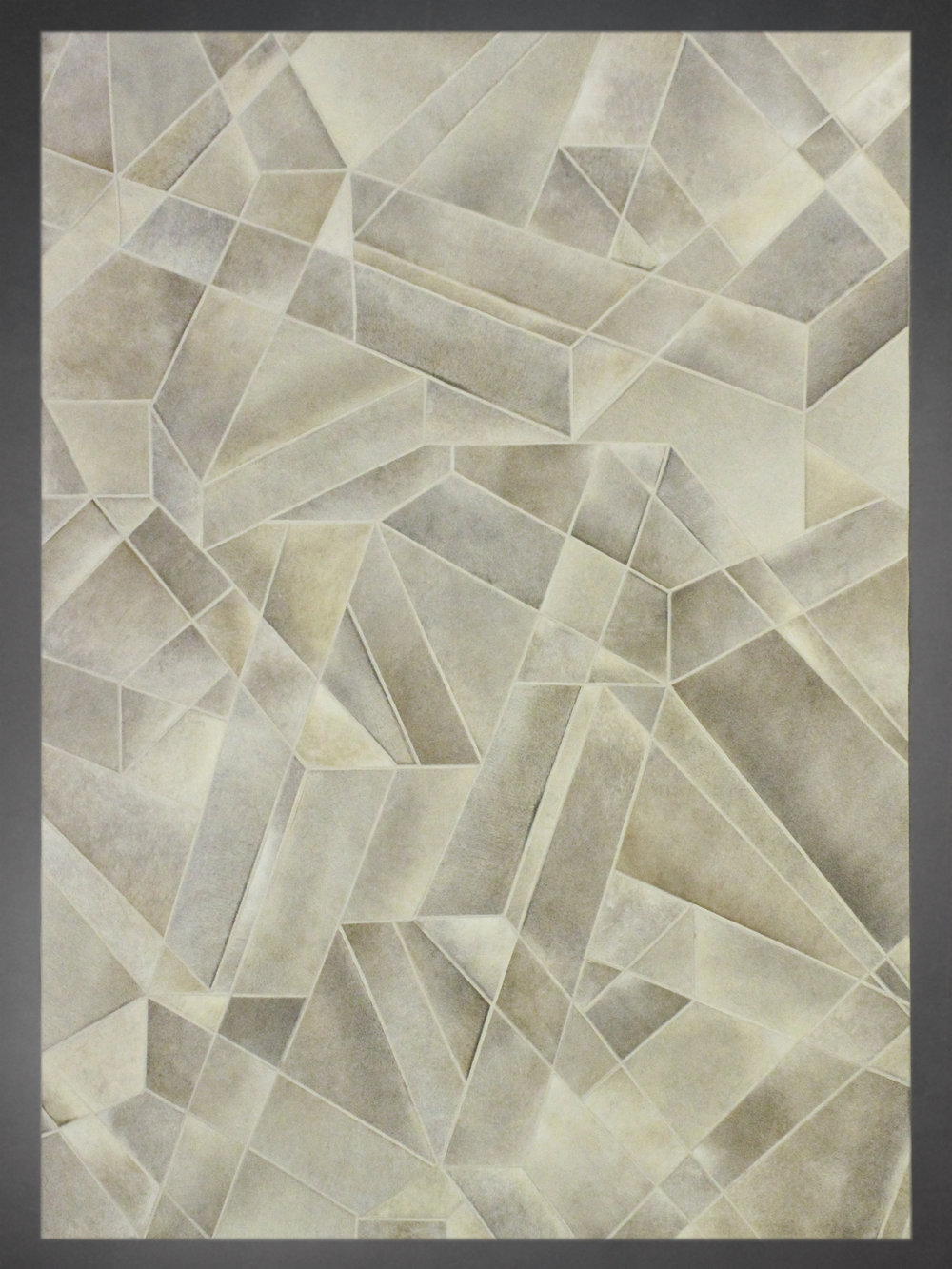 Contemporary designed fur rug in a multi fauceted pattern in gold.