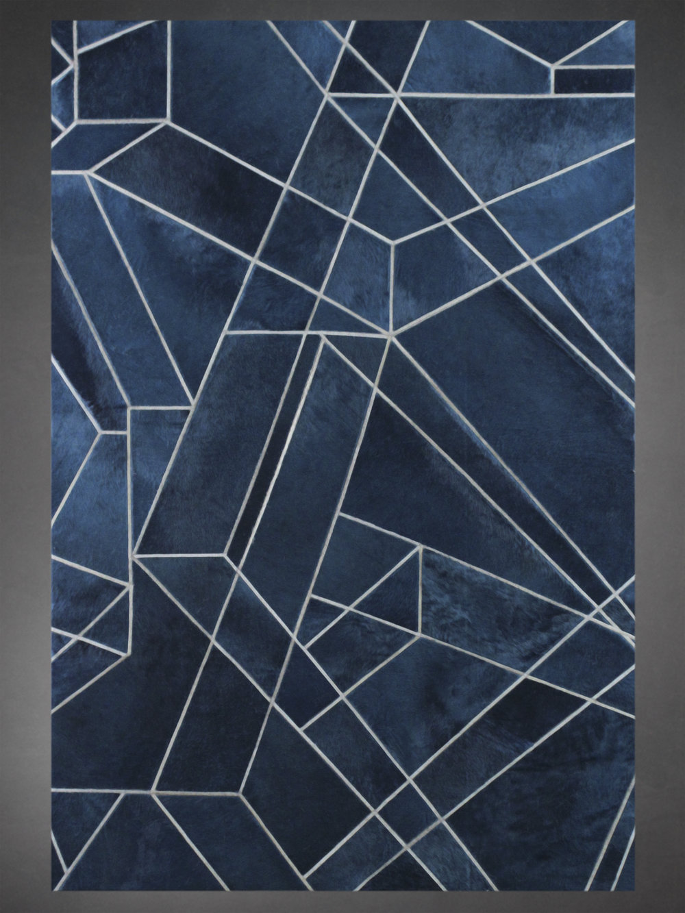 Contemporary designed fur rug in the Perspective style by Yerra in petroleum and stone blues.
