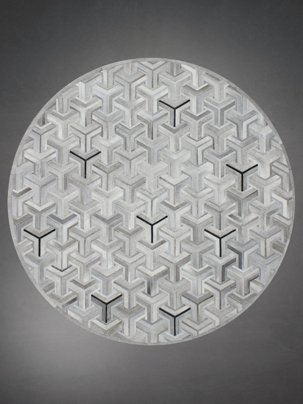 Contemporary designed fur circle rug in a geometric woven pattern in gray.