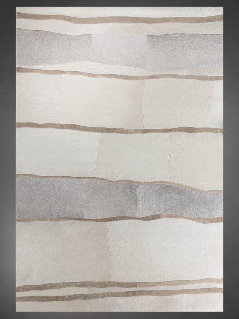 Contemporary designed fur rug in a abstract pattern in white, gray and taupe.