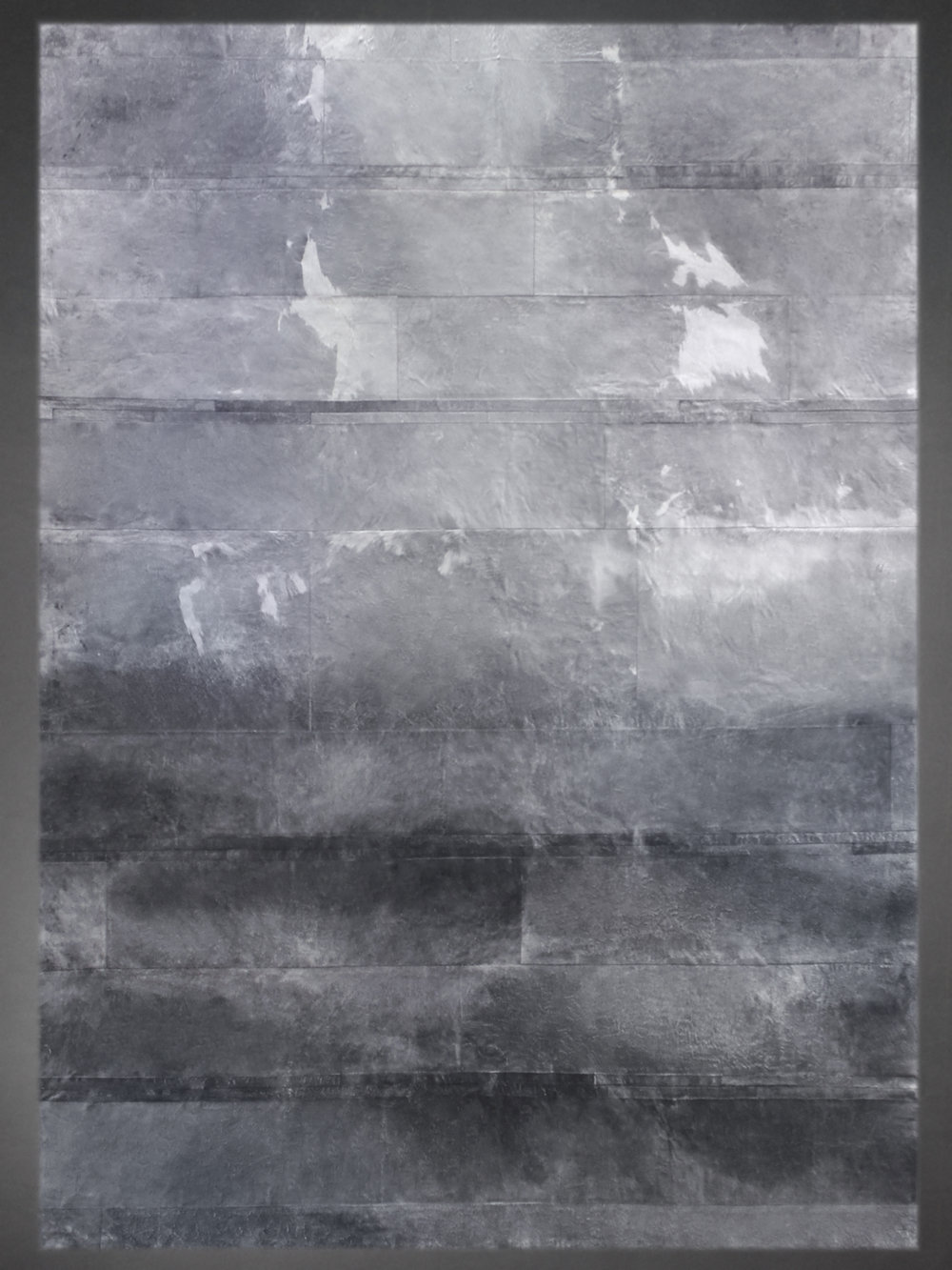 Contemporary designed fur rug in the Watercolor style by Yerra in light and dark grays.