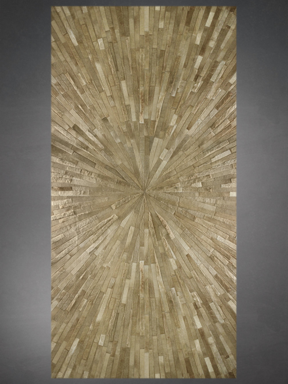 Contemporary designed fur rug in a starburst pattern in gold.
