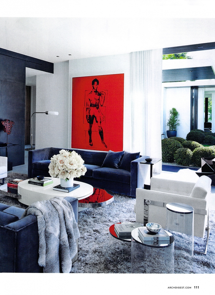 A contemporary, modern home with a fur rug in an Angora style in silver.