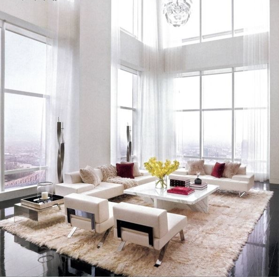 A contemporary, modern home with a fur rug in off-white cream.