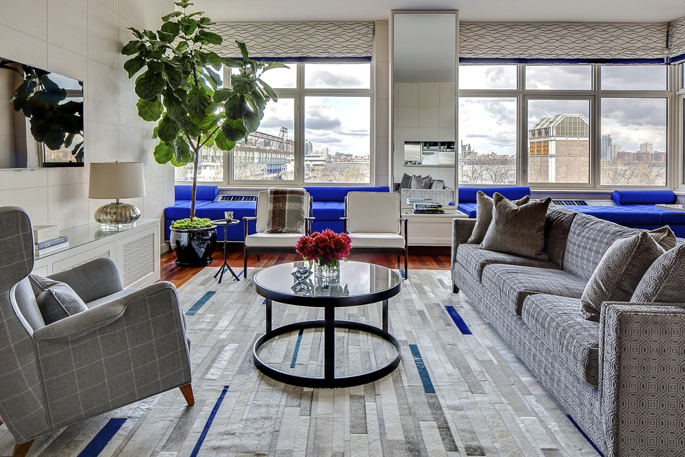 A contemporary, modern home with a fur rug in a geometric striped pattern in white and blue.