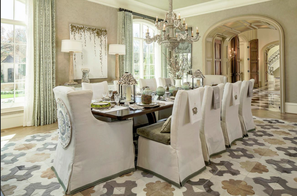 A contemporary, modern home with a fur rug in a geometric pattern in white and gold.