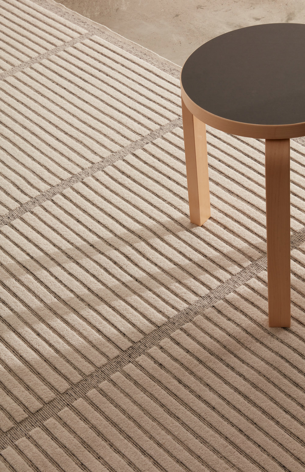 Aline Area Rug shown in 100% Cruelty-Free Merino in Breath and Ink in 5x7 size.
