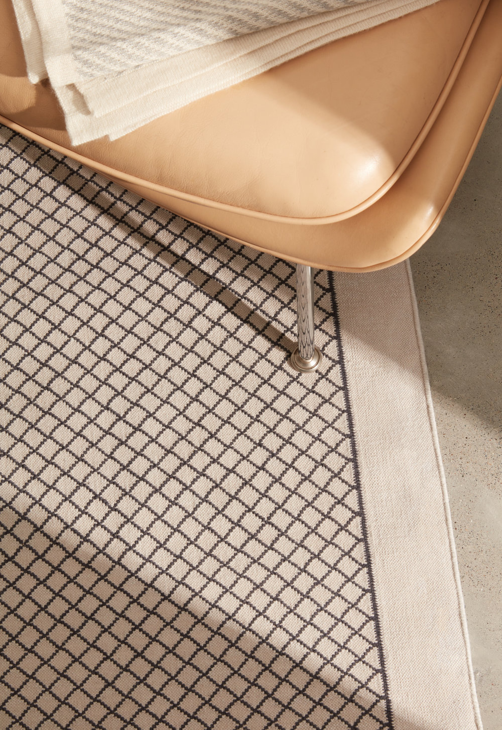 Fiske Area Rug shown in 100% Cruelty-Free Merino in Breath and Ink in 5x7 size.