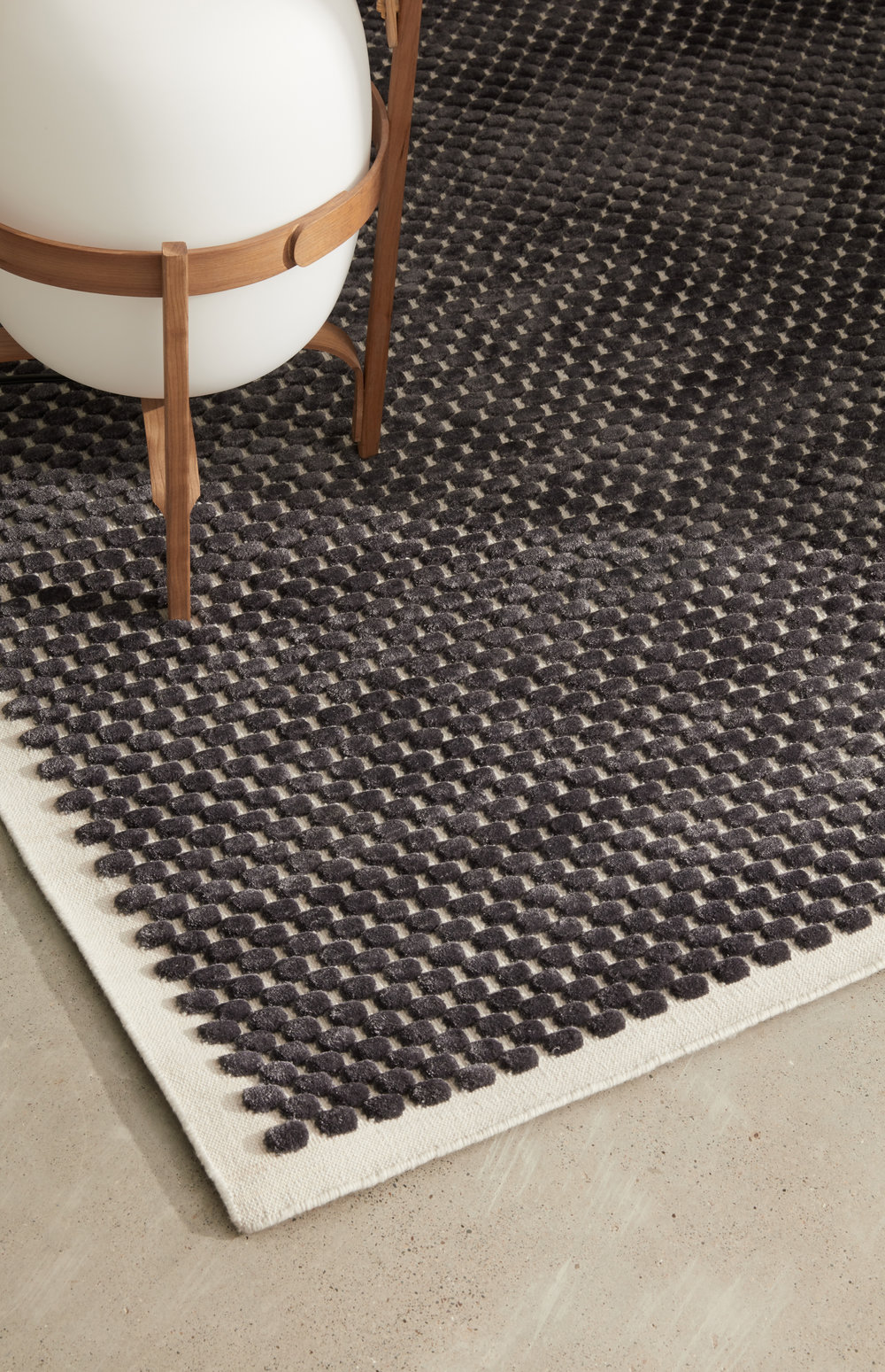 Kupla Area Rug Shown in 100% Cruelty-Free Merino & 100% Silk in Breath and Ink in 5x7 size.
