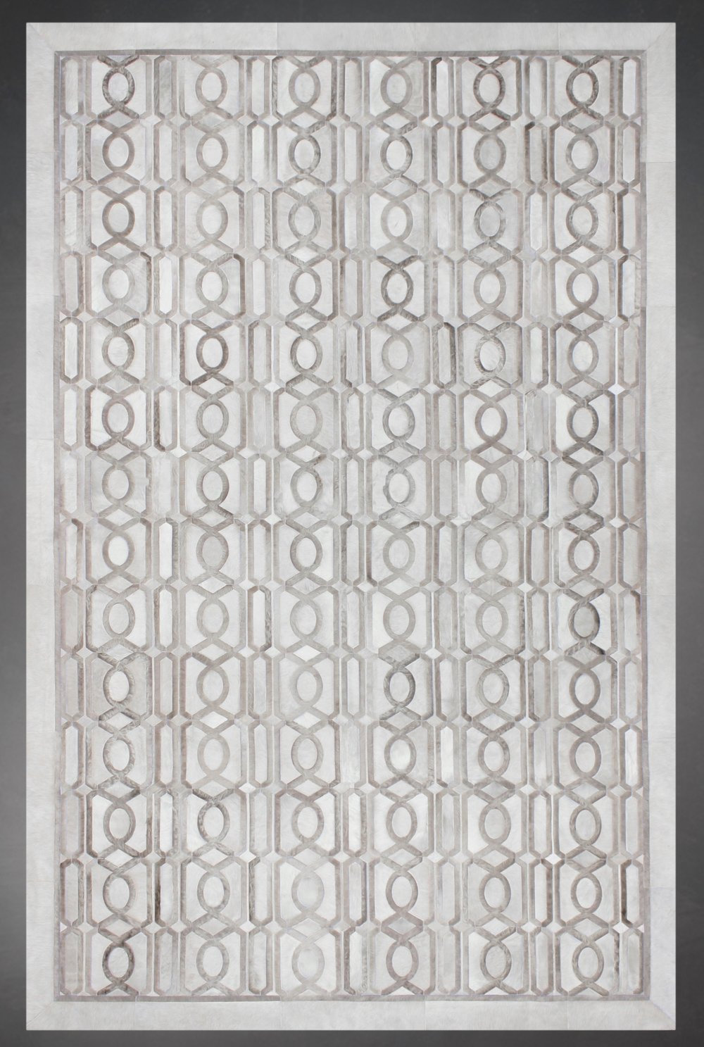 Contemporary designed fur rug in a geometric pattern in cream and brown.