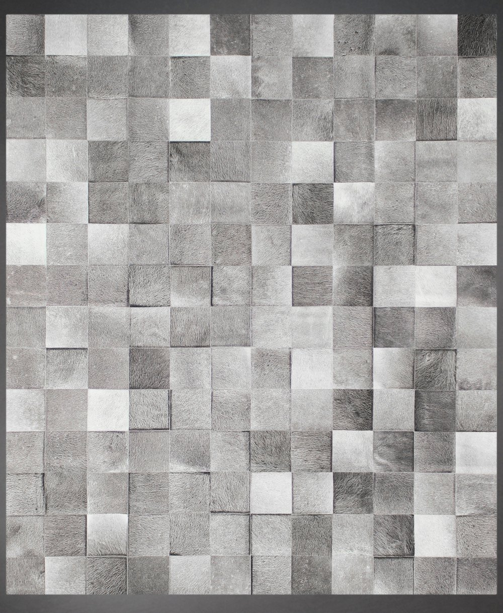 Contemporary designed fur rug in a square pattern in grays and browns.