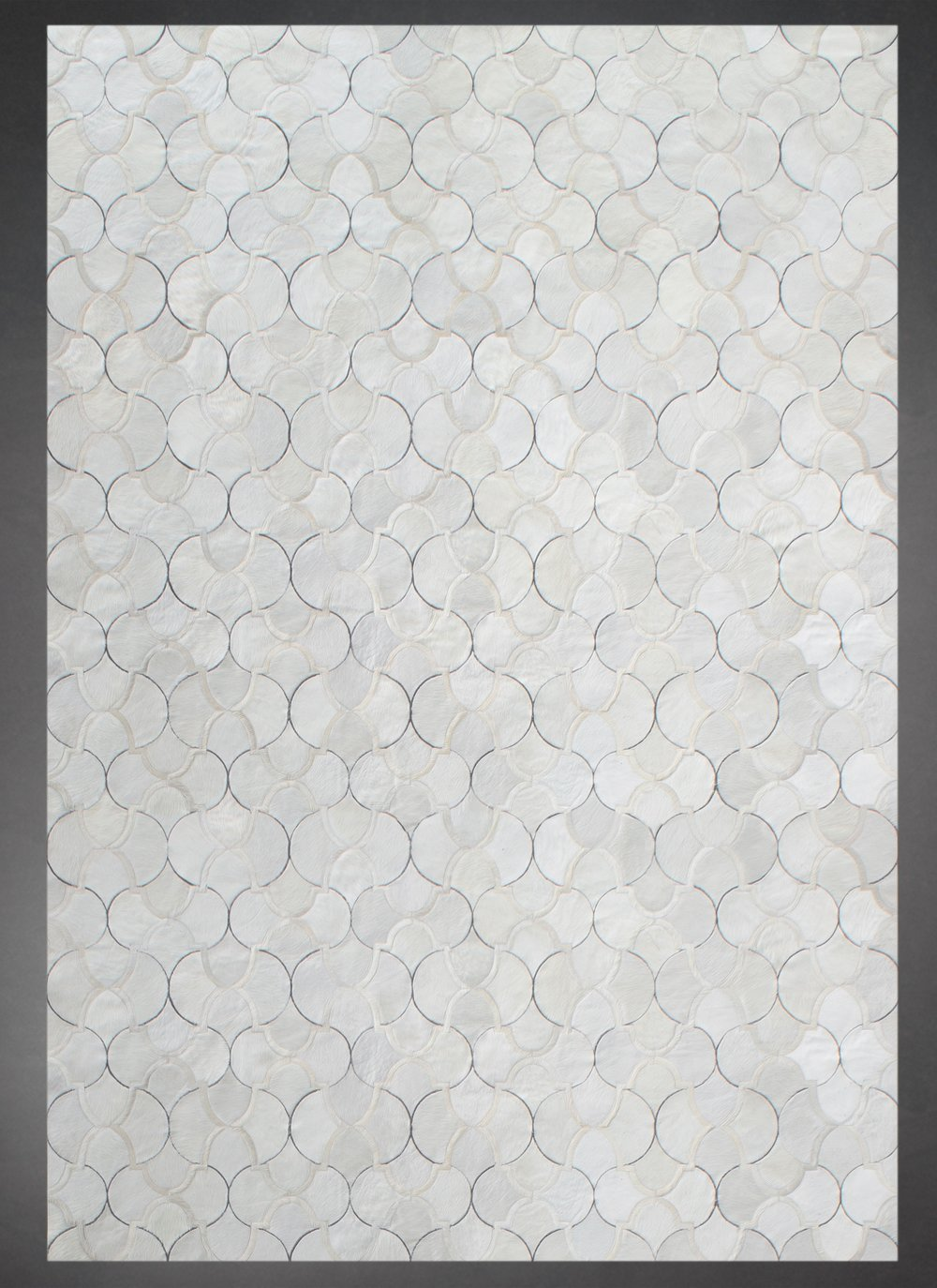 Contemporary designed fur rug in a geometric pattern in cream.