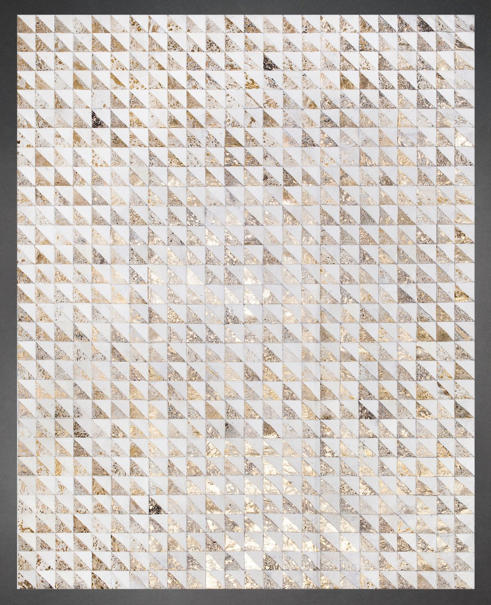 Contemporary designed fur rug in a triangle pattern in milk white and gold metallic.