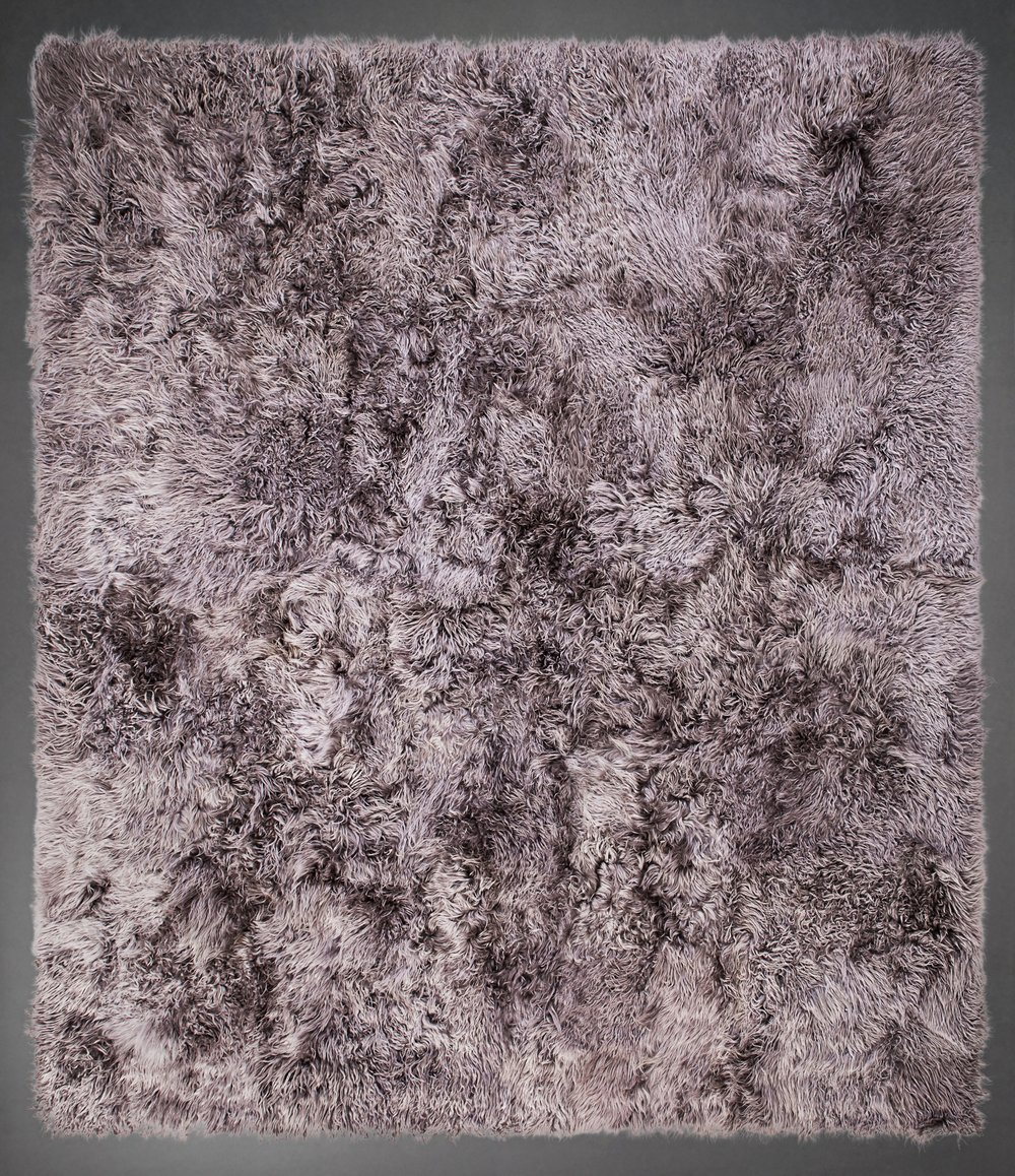 Contemporary designed fur rug in the Angora style by Yerra in silver.
