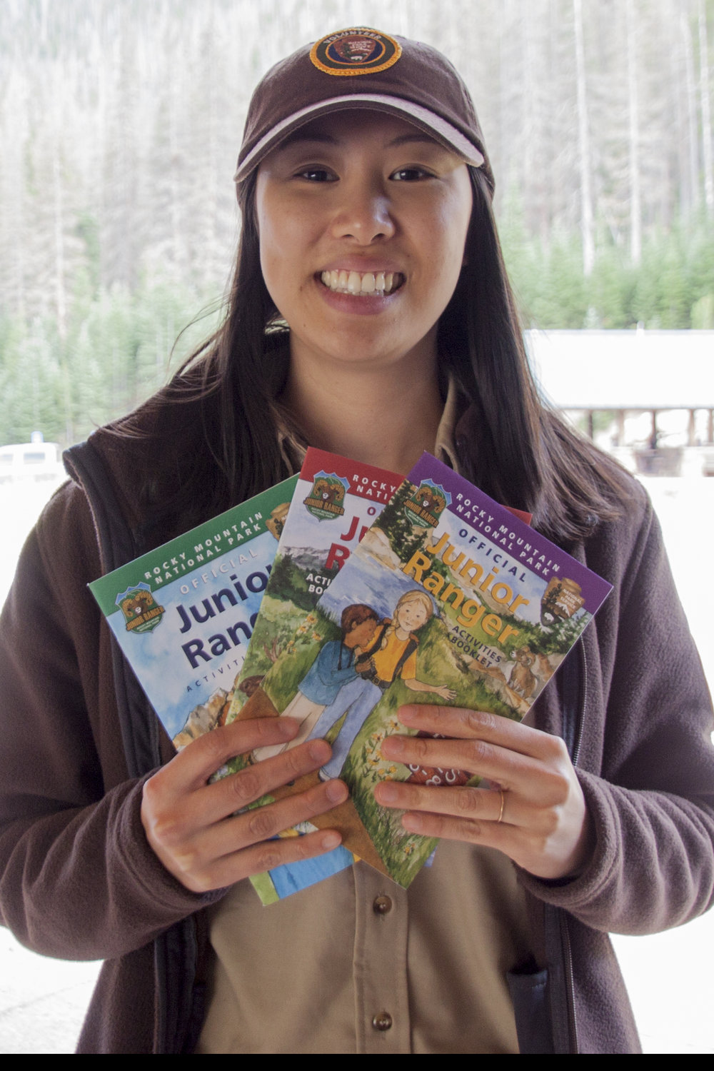 Here I am with the three Rocky Mountain National Park Junior Ranger books, in my volunteer uniform!  Photo by Melissa Jasper
