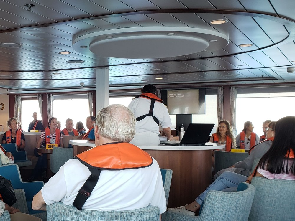 The captain told us how to be safe on the ship.  Photo by Alison Travis